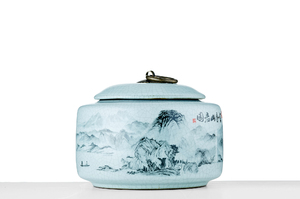 Round Tea Caddy With Crackle Glaze And Picture Of The Wyui Mountains