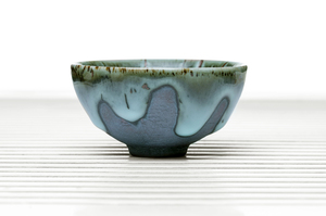Footed Hemisphere Tea Bowl With Blue Drip Glaze
